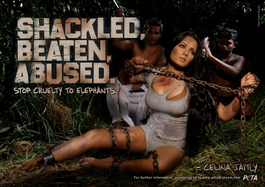 "Woman on the ground wrapped in chains, legs spread and exposed, cleavage. Reads: ""Shackled, Beaten, Abused."""