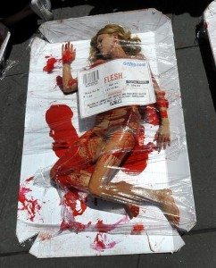 Woman laying under plastic wrap like a piece of meat with a bar code.