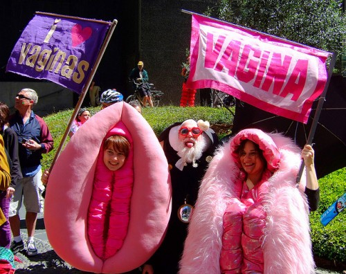 "Women dressed in vagina costumes wave banners that read: ""VAGINA"" and ""I heart Vaginas"""