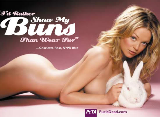 "Reads ""I'd rather show my buns than wear fur."" Shows a naked white woman prostrate on the ground touching a rabbit."