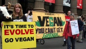 Vegan campaigners hold signs at a demo