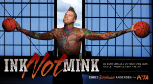 Basketball player, shirtless, heavily tattooed, has arms spread out, head faced up, holding a basketball in each hand