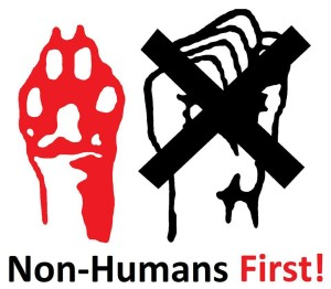 "Reads ""Non-Humans First!"" Image of upraised dog paw and human fist, with human fist crossed out"