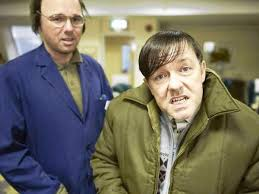 "Pilkington and Gervais on the set of ""Derek."" Gervais is making a face and has arranged his hair in a stereotypical way to suggest mental retardation."