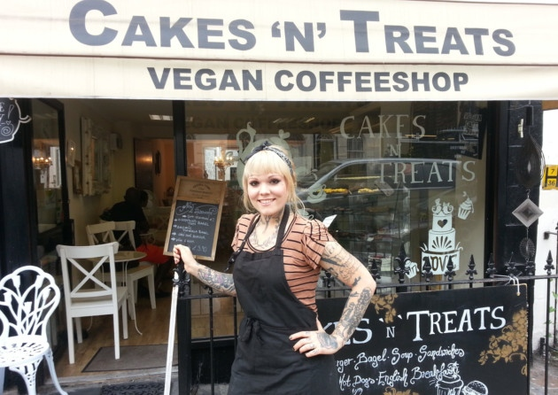"""Owner of """"Cakes 'n' Treats Vegan Coffeeshop"""" poses in front of her store"""
