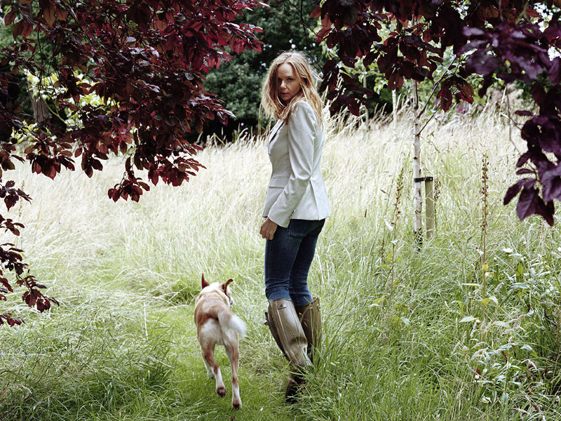 Stella McCartney and dog walking on trail
