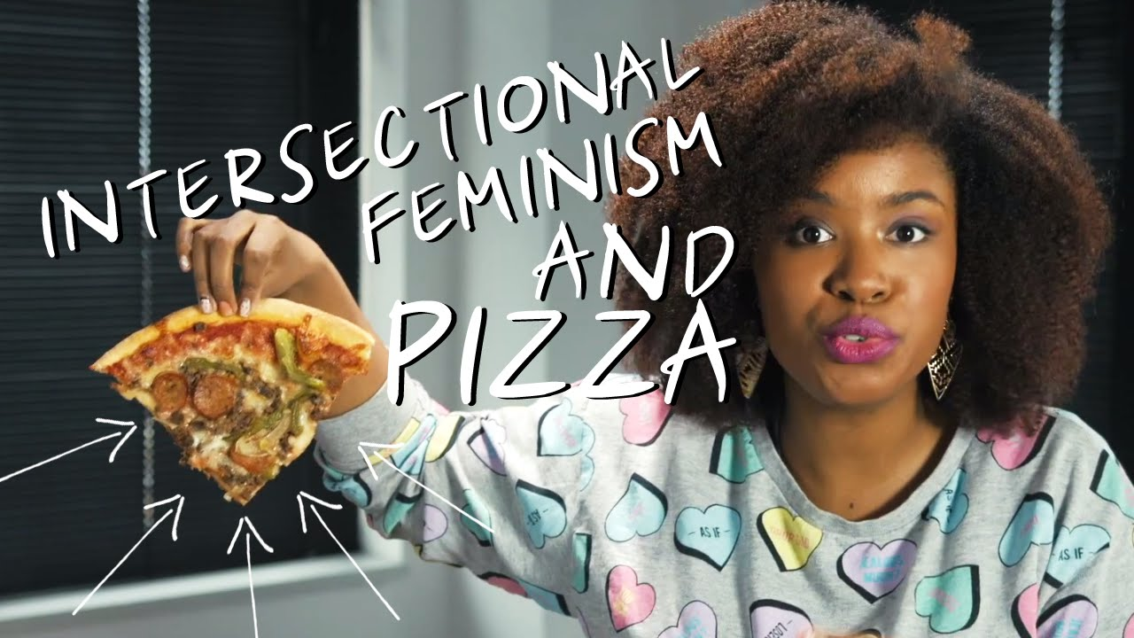 Akilah holding a piece of pizza