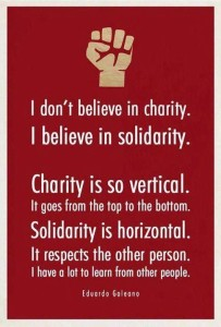 Poster stating charity is vertical and solidarity is horizontal