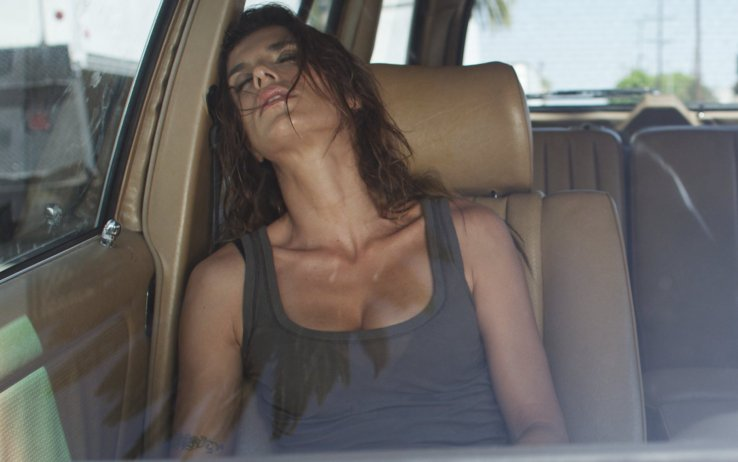 Elisabetta Canalis in low cut tank top sweaty and passed out in the front seat of a car