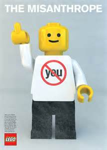 "Lego man wearing a shirt with the word ""you"" crossed out while he flips the middle finger"
