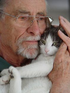 Older man cuddling cat