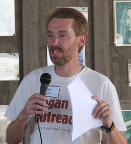 Male-identified vegan leader gives talk with microphone