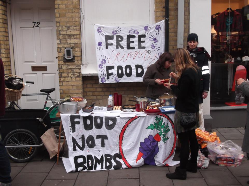 Free vegan food being offered at a Food Not Bombs tabling