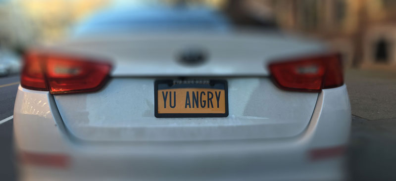 "License plate of an automobile that reads, ""YU ANGRY"""